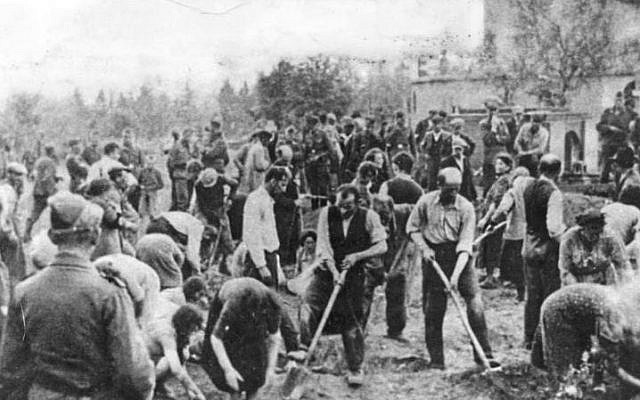Jews being forced to dig their own graves in Storow, Ukraine, July 1941